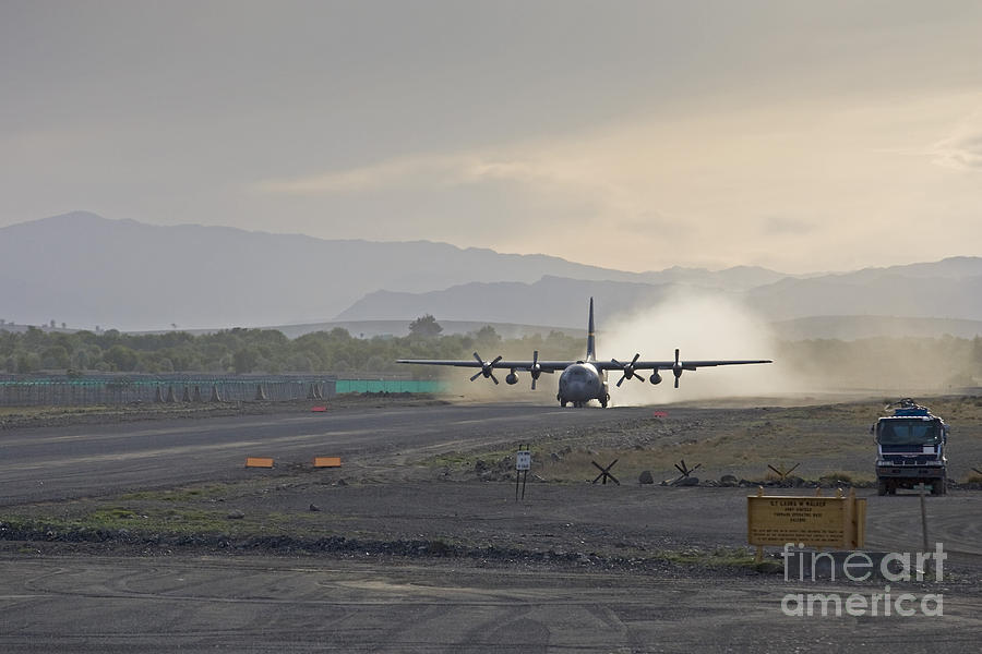 C-130 Photograph - A C-130 Taking Off by Tim Grams