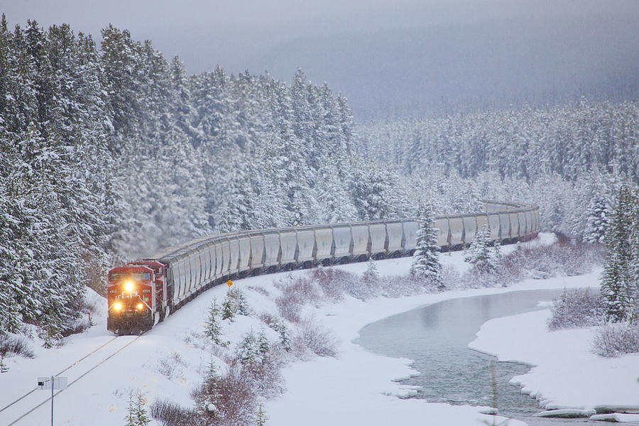 Canada Photograph - A Canadian Pacific Train Travels Along by Chris Bolin