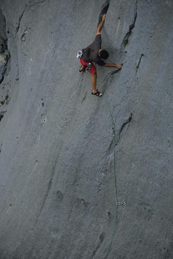 Adventure Sports Photograph - A Caucasian Man Rock Climbing by Bobby Model