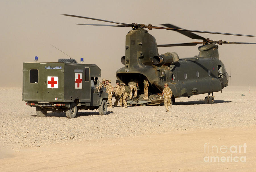 Soldier Photograph - A Ch-47 Chinook Helicopter Drops by Andrew Chittock
