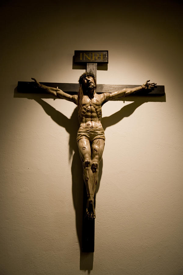 New Mexico Photograph - A Crucifix In The Old Saint Francis by Stephen St. John