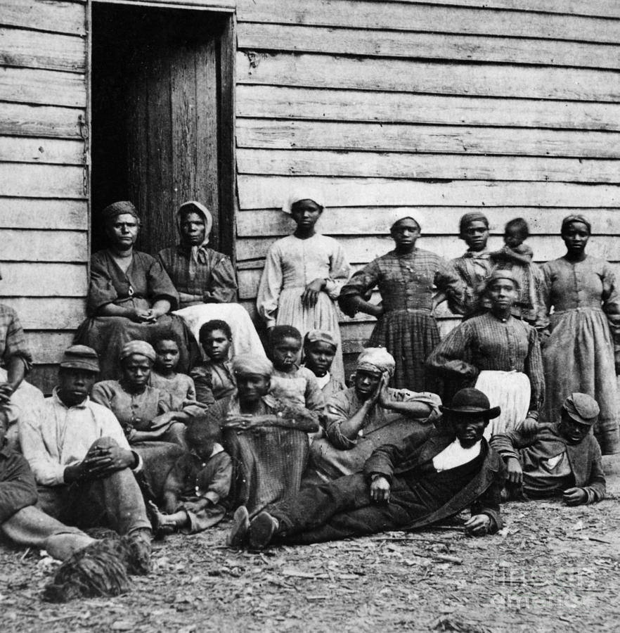 Slavery Photograph - A Group Of Slaves by Photo Researchers