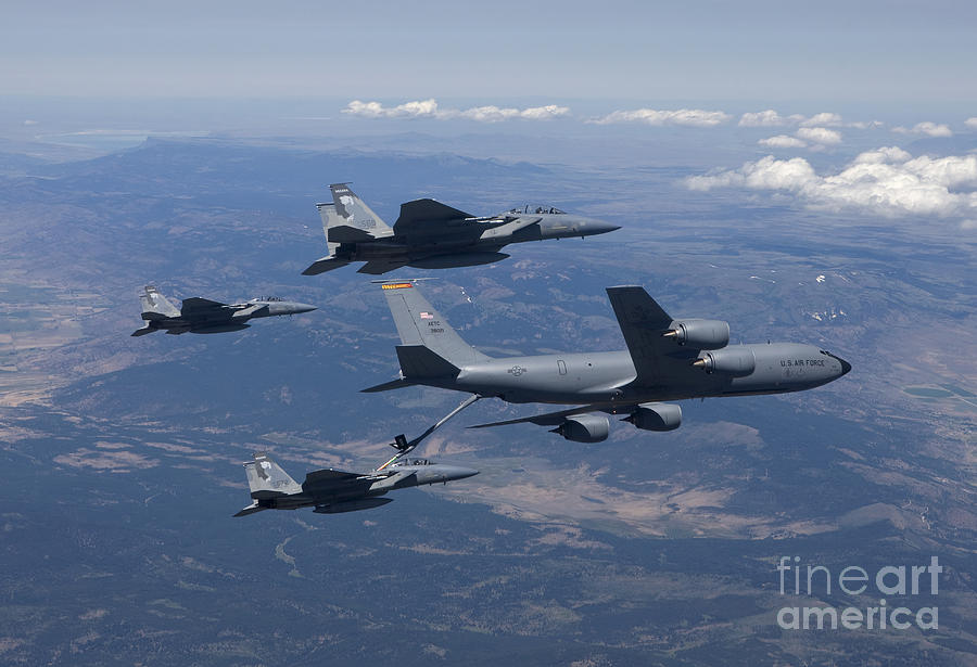 Color Image Photograph - A Kc-135r Stratotanker Refuels Three by HIGH-G Productions