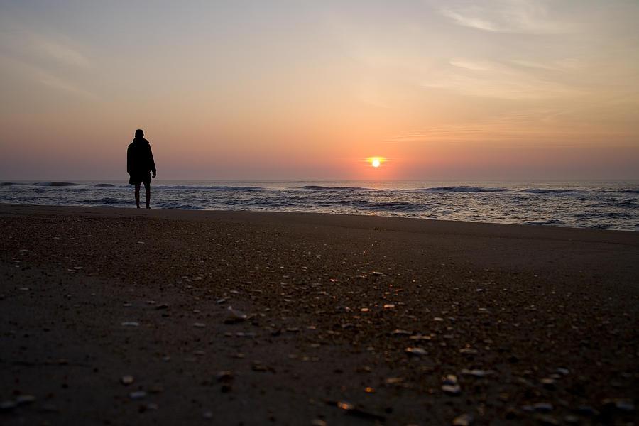 North Carolina Photograph - A Lone Figure Enjoys The Ocean Sunrise by Stephen St. John