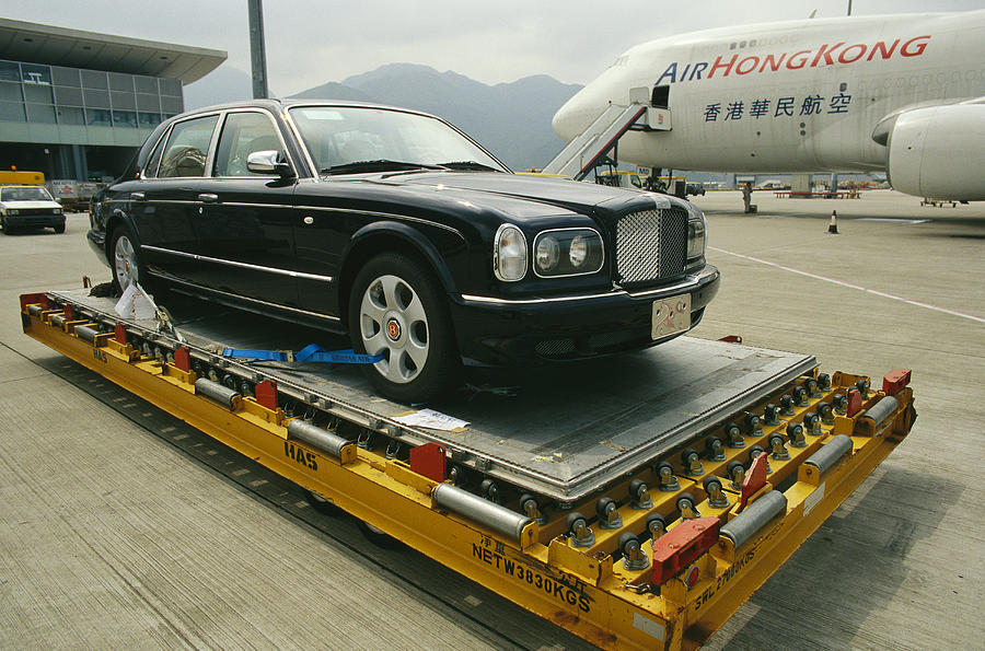 Asia Photograph - A Luxury Bentley Unloaded From An by Justin Guariglia