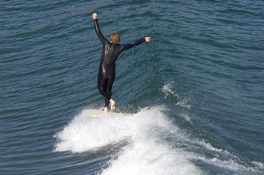 Surfing Photograph - A Man Surfs A Longboard At Refugio by Rich Reid