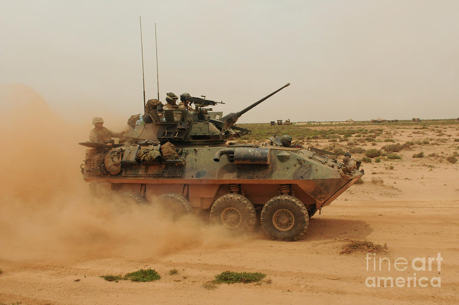 Dust Photograph - A Marine Corps Light Armored Vehicle by Stocktrek Images