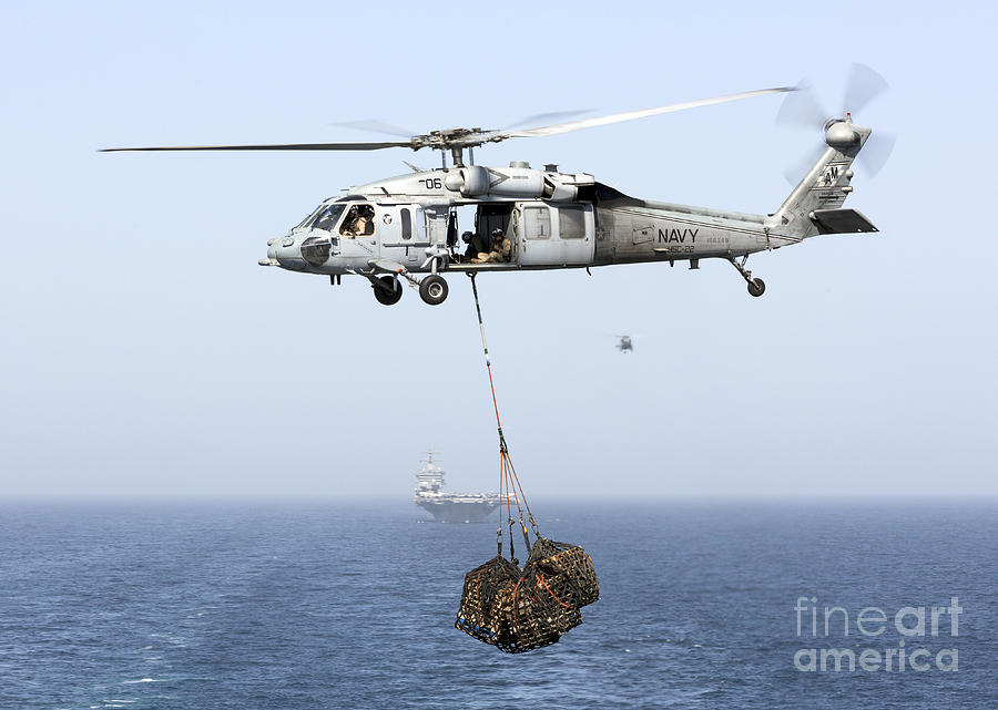 Arabian Sea Photograph - A Mh-60 Helicopter Transfers Cargo by Gert Kromhout