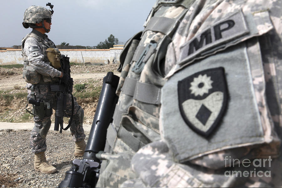 Afghanistan Photograph - A Military Police Officer Provides by Stocktrek Images