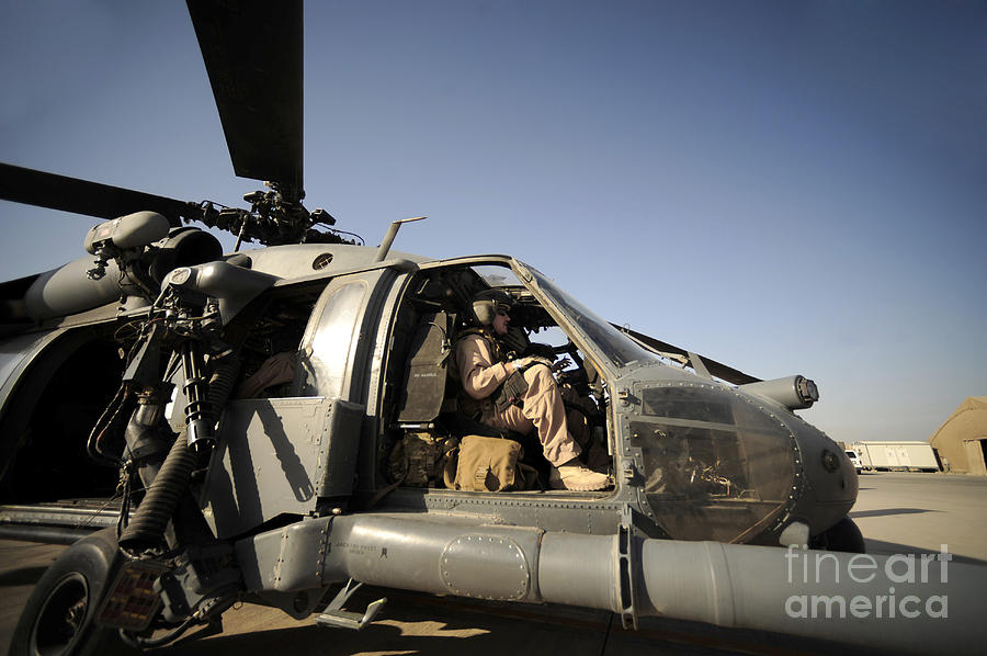 Operation Enduring Freedom Photograph - A Pilot Sits In The Cockpit Of A Hh-60g by Stocktrek Images