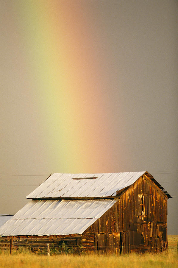 Sky Photograph - A Rainbow Arches From The Sky Onto by Michael S. Lewis