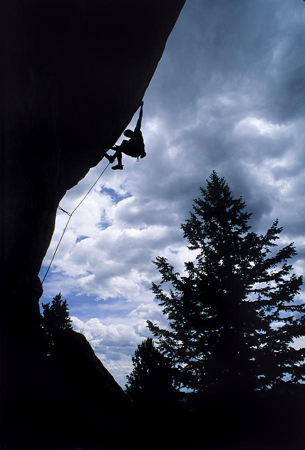 Young Adult Man Photograph - A Rock Climber Ascends A Steep Route by Bill Hatcher