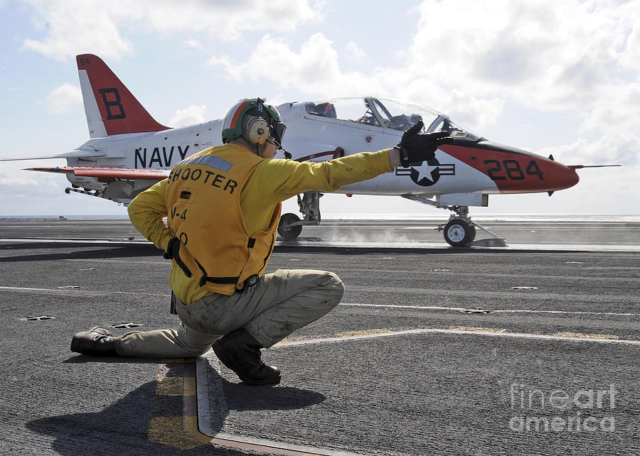 Motioning Photograph - A Shooter Launches A T-45 Goshawk by Stocktrek Images