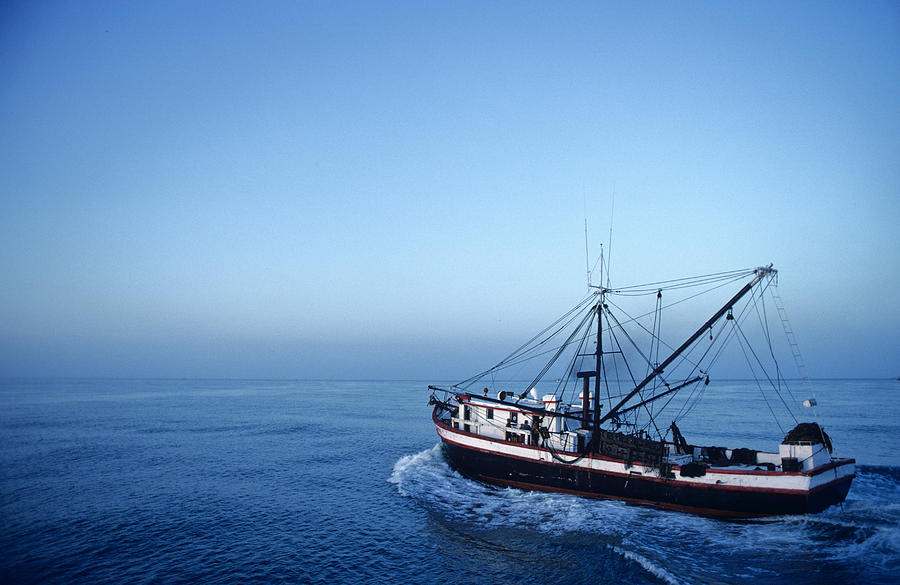 Shrimp Boats Photograph - A Shrimp Boat In The Gulf Of Mexico by Kenneth Garrett