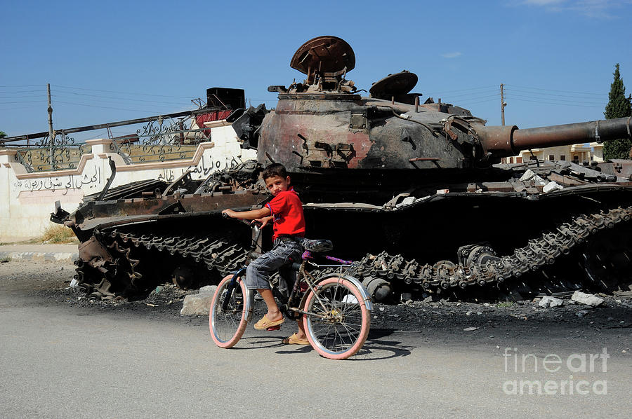 Free Syrian Army Photograph - A Syrian Boy On His Bicycle In Front by Andrew Chittock