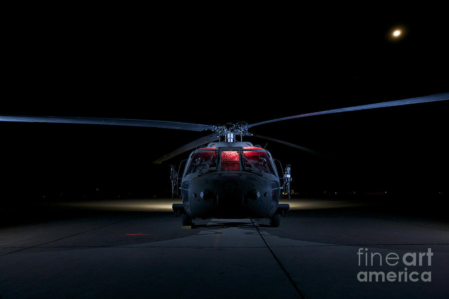 Operation Iraqi Freedom Photograph - A Uh-60 Black Hawk Helicopter Lit by Terry Moore