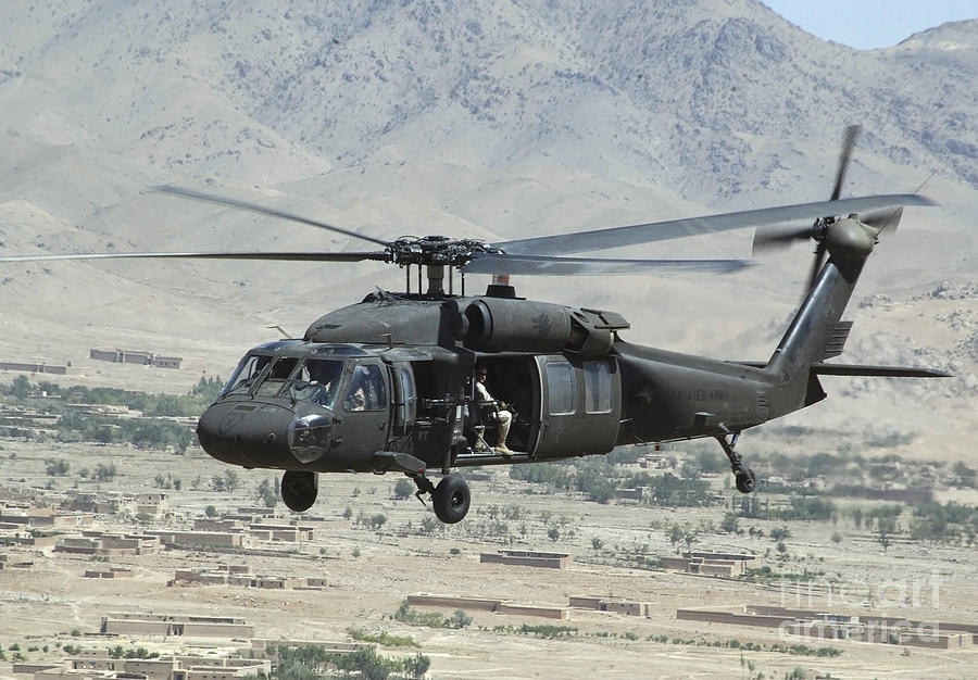 Horizontal Photograph - A Uh-60 Blackhawk Helicopter by Stocktrek Images