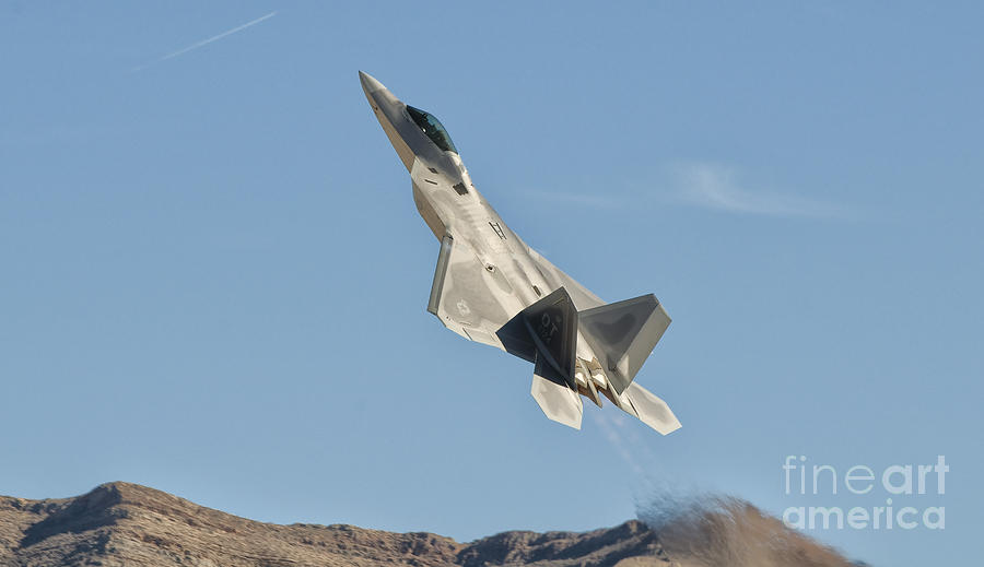 Transportation Photograph - A U.s. Air Force F-22 Raptor Takes by Giovanni Colla