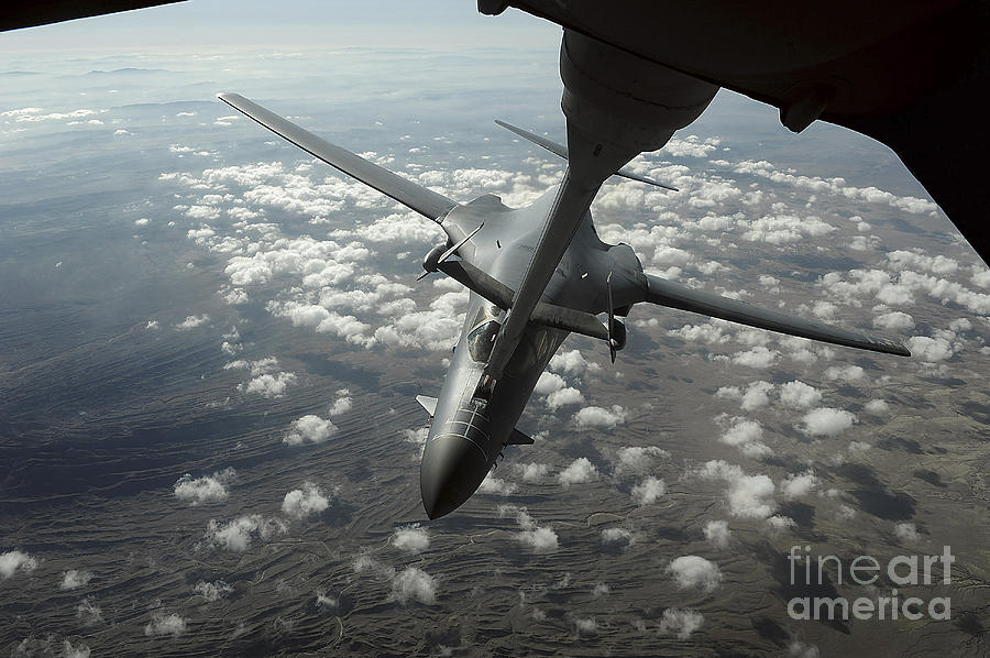 In-flight Photograph - A U.s. Air Force Kc-10 Refuels A B-1b by Stocktrek Images