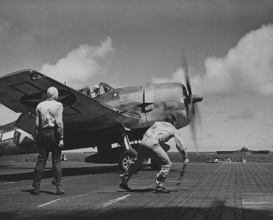 Plane Photograph - A Us Navy Fighter Pilot Gets The Take Off Flag From The Deck Crew Of An Aircraft Carrier by American School