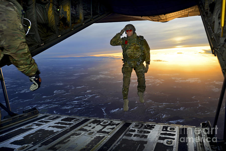 C-130 Photograph - A U.s. Soldier Salutes His Fellow by Stocktrek Images