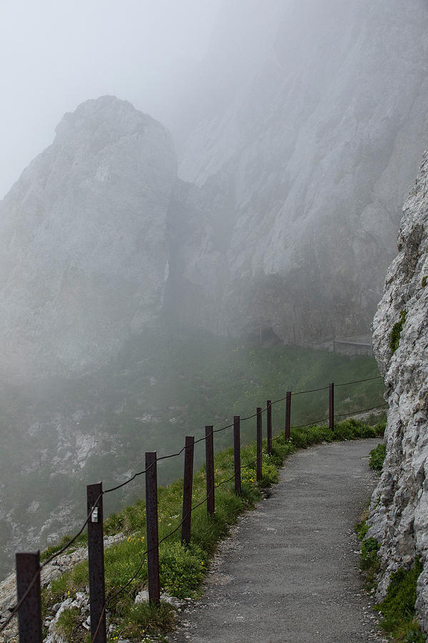 Alps Photograph - A Walk In The Clouds by Stephen Stookey