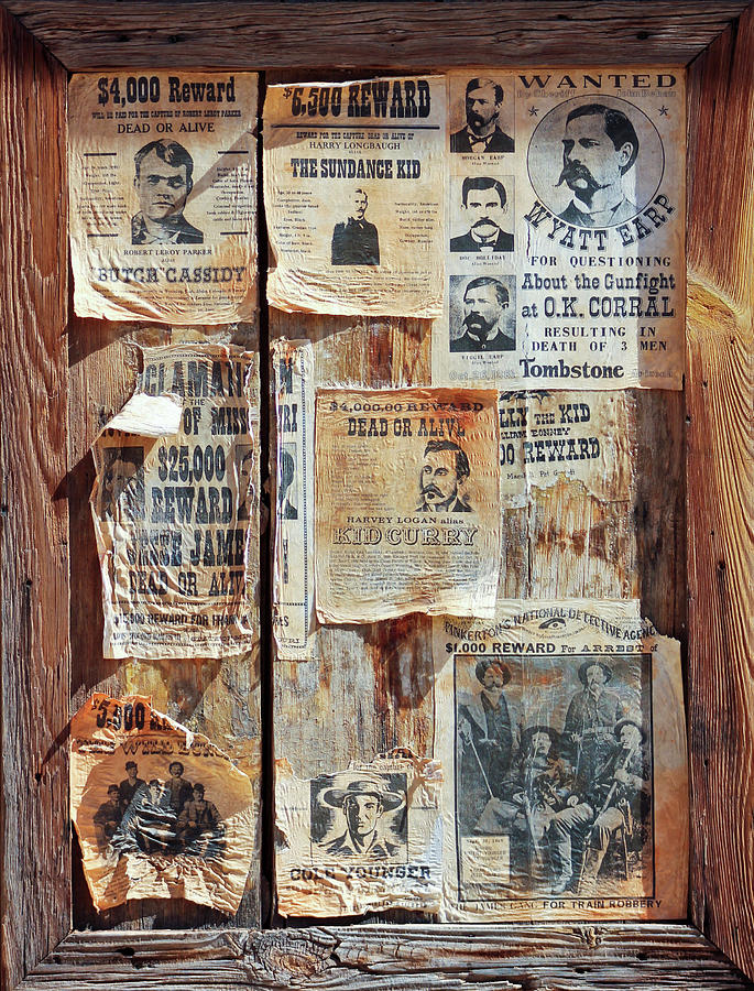 History Photograph - A Wooden Frame Full Of Wanted Posters by Derrick Neill