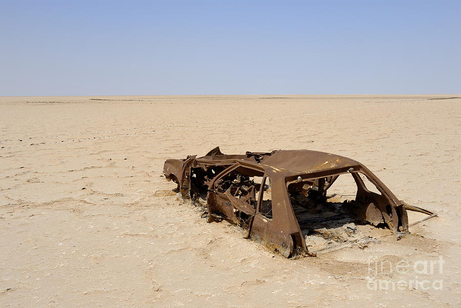 Destruction Photograph - Abandoned And Rusty Car Wreck In Desert by Sami Sarkis