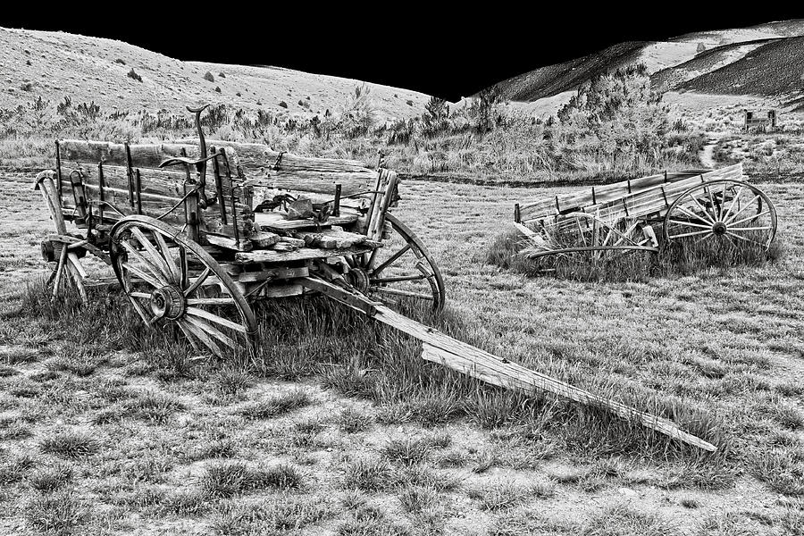 Wagon Photograph - Abandoned Wagons Of Bannack Montana Ghost Town by Daniel Hagerman