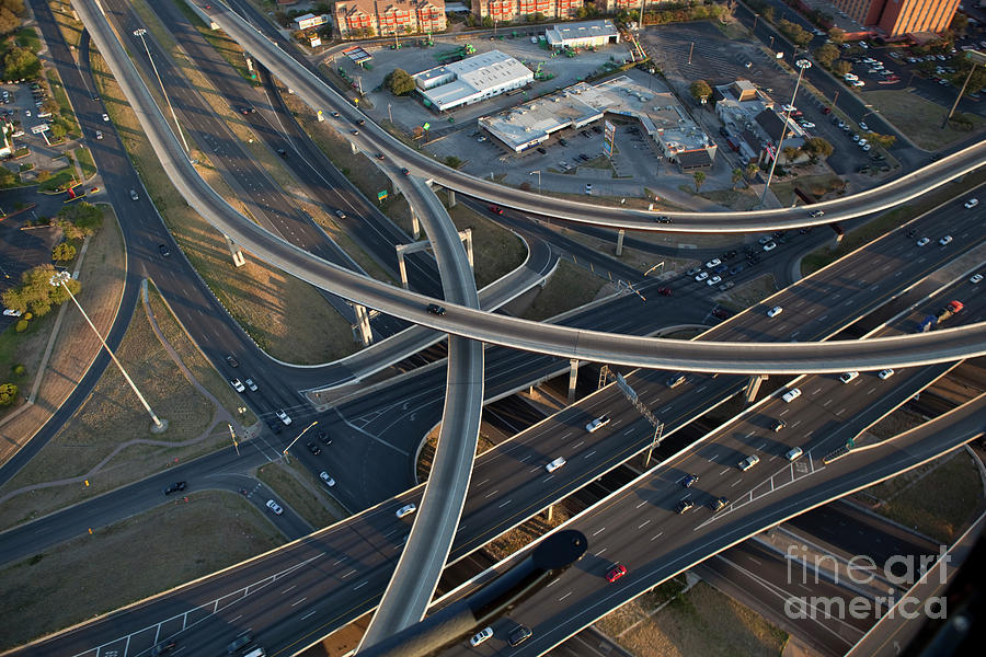 Aerial View Photograph - Aerial View From A Helicopter Of I-35 And 290 Interstate Highway Interchanges In Austin, Texas by Herronstock Prints