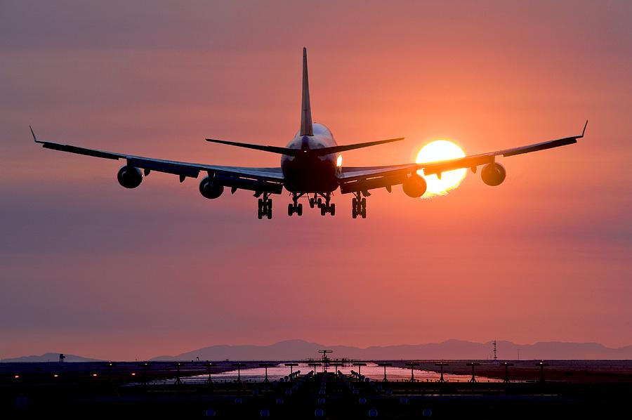Boeing 747 Photograph - Aeroplane Landing At Sunset, Canada by David Nunuk