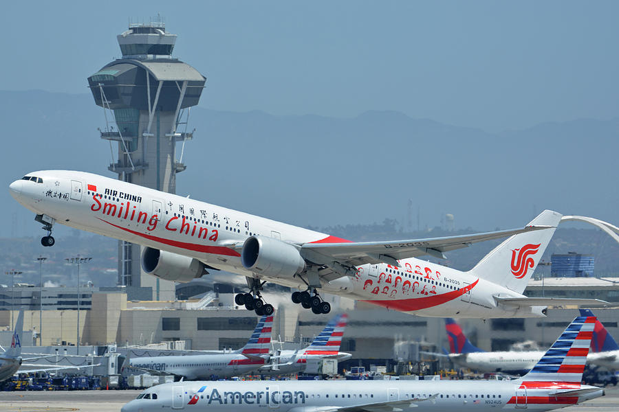 Airplane Photograph - Air China Boeing 777-39ler B-2035 Smiling China Los Angeles International Airport May 3 2016 by Brian Lockett