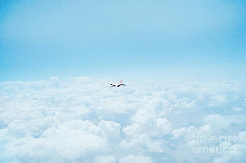 Airplane in the  clouds by Joyce A Rogers