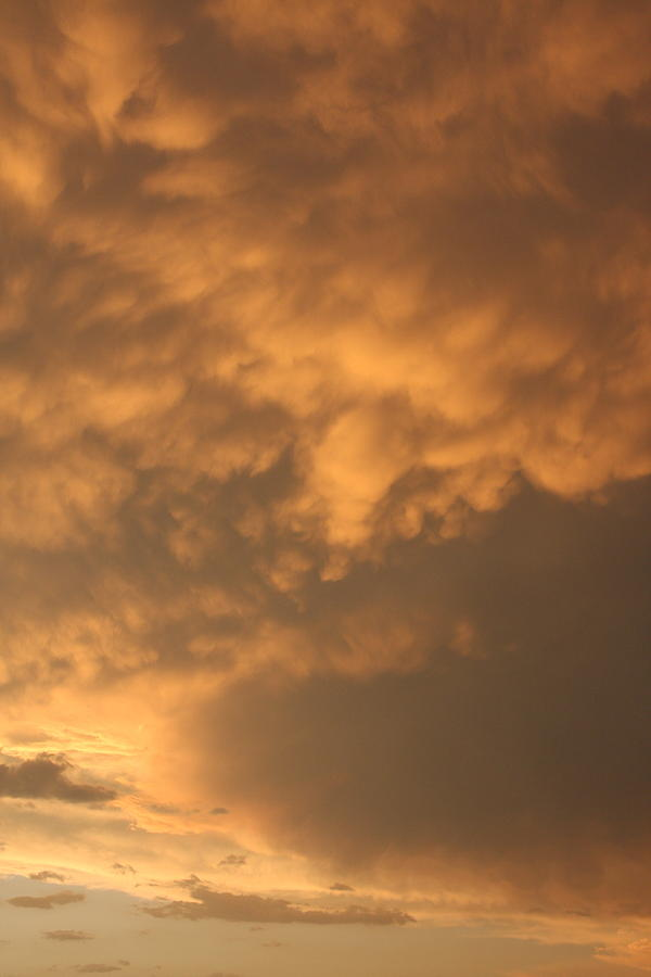 Clouds Photograph - Amber Twilight by Jonathan Kotinek