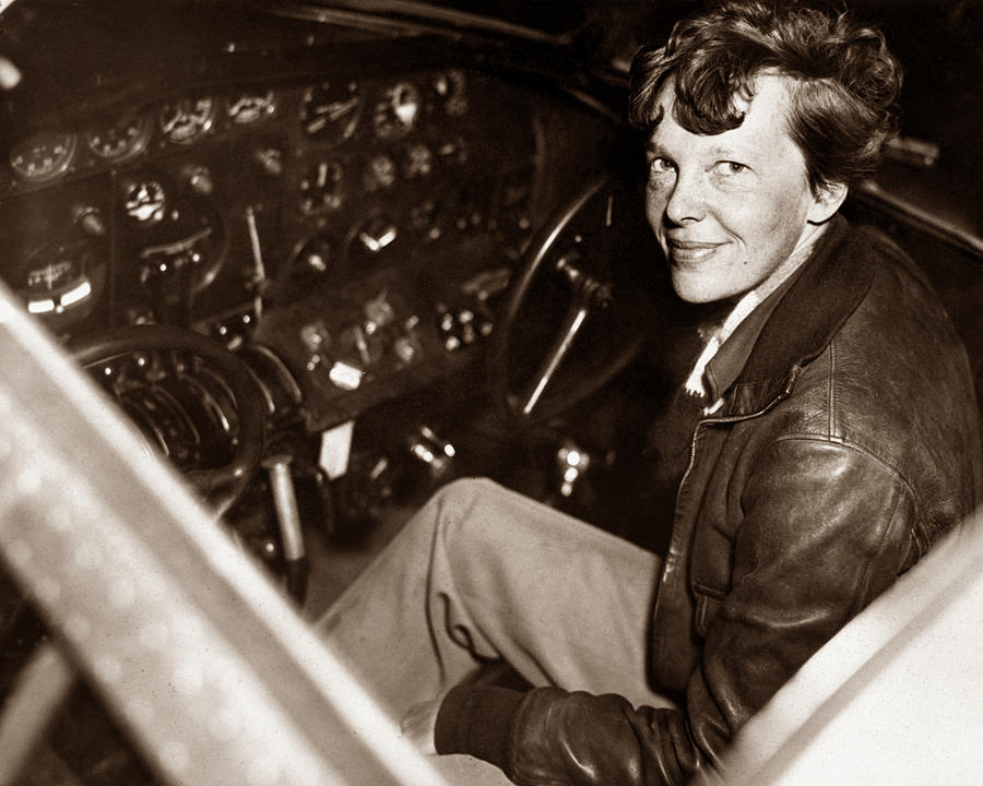 Amelia Earhart Sitting In Airplane Cockpit Photograph