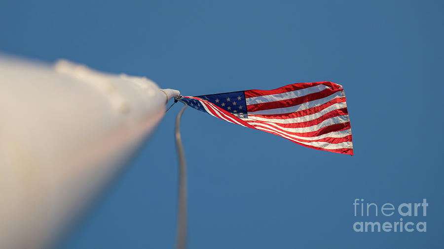Usa Photograph - American Flag At The End Of Tall Post With Blue Skies by PorqueNo Studios