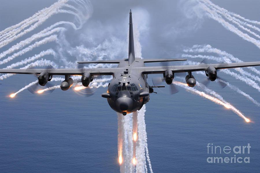 Ac-130 Photograph - An Ac-130h Gunship Aircraft Jettisons by Stocktrek Images