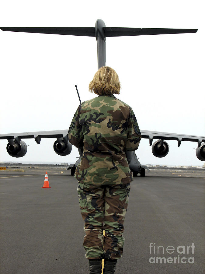 Aeromedical Photograph - An Airfield Manager Greets An Arriving by Stocktrek Images