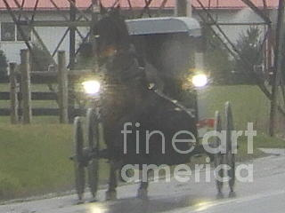 Amish Photograph - An Amish Family Travels Home In The Evening by Christine Clark