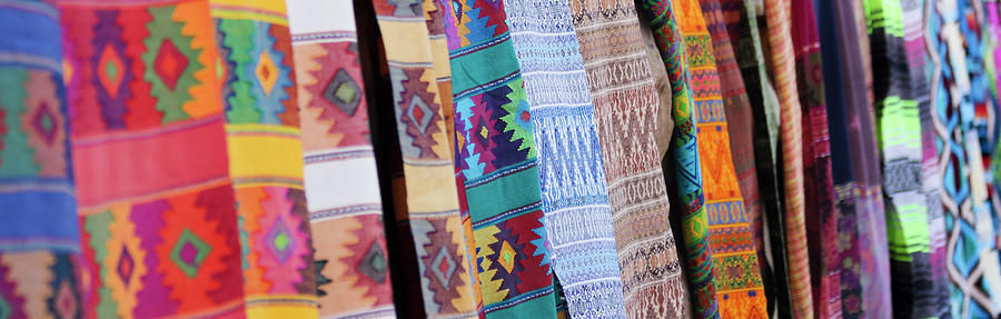 Blanket Photograph - An Assortment Of Colorful Blankets Hanging In A Row by Derrick Neill