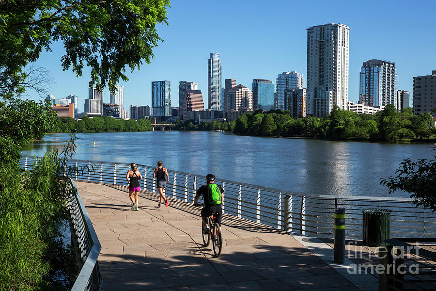 Boardwalk Photograph - An Early Morning Sunrise Greets Runners And Bikers On The Boardwalk Trail Part Of The Lady Bird Lake Hike And Bike Trail In Downtown Austin Texas by Austin Welcome Center