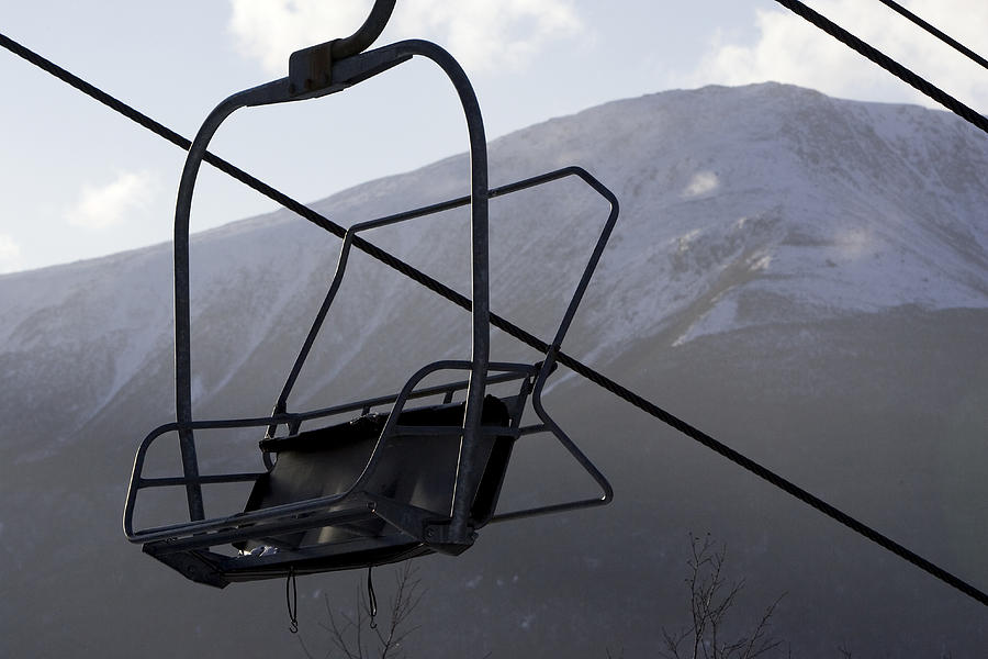 Ski Lifts Photograph - An Empty Chair Lift At A Ski Resort by Tim Laman