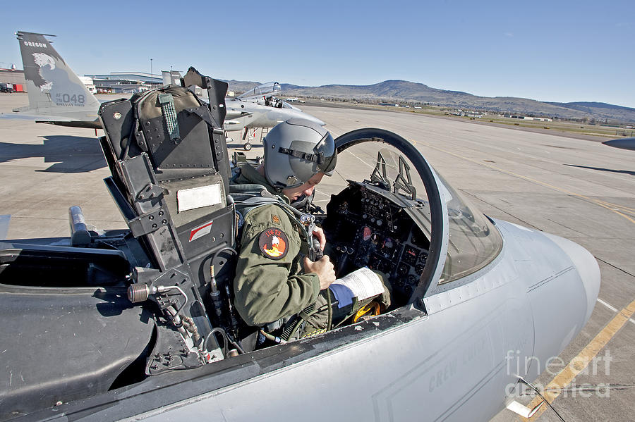 Cockpit Photograph - An F-15 Pilot Performs Preflight Checks by HIGH-G Productions