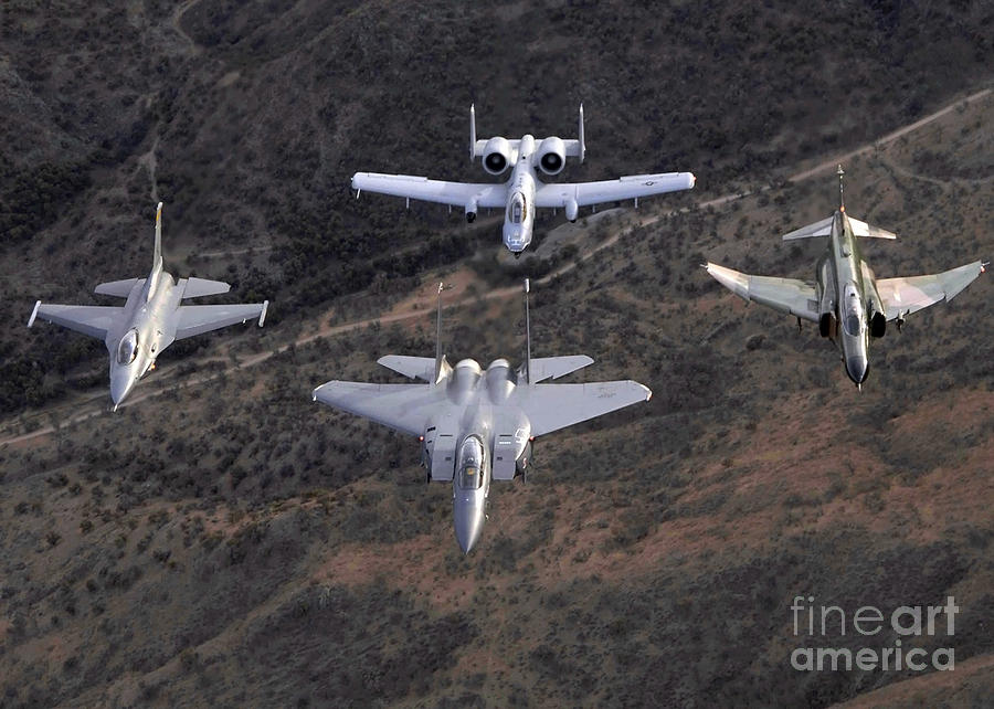 Horizontal Photograph - An F-16 Fighting Falcon, F-15 Eagle by Stocktrek Images