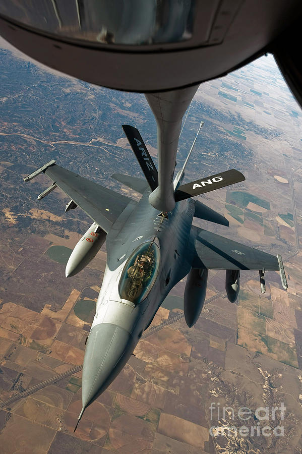 Air-to-air Photograph - An F-16 Fighting Falcon Receiving Fuel by Stocktrek Images