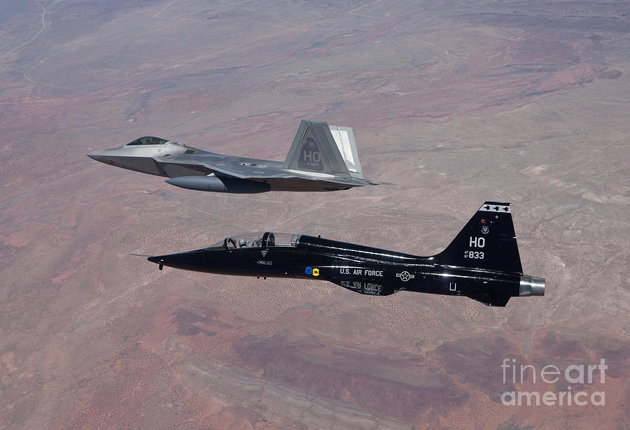 Air Superiority Fighter Photograph - An F-22 Raptor And A T-38 Talon Fly by HIGH-G Productions