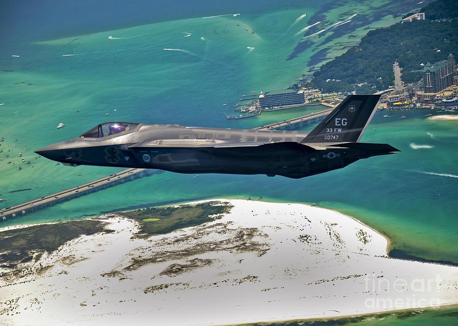 Stealth Photograph - An F-35 Lightning II Flies Over Destin by Stocktrek Images