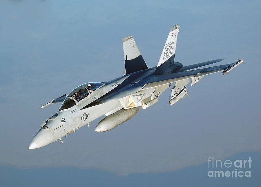 Horizontal Photograph - An Fa-18f Super Hornet Conducts by Stocktrek Images