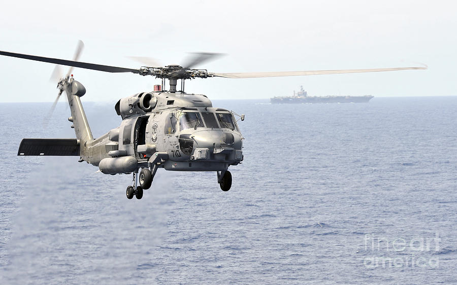 Mh-60 Photograph - An Mh-60r Seahawk Helicopter In Flight by Stocktrek Images