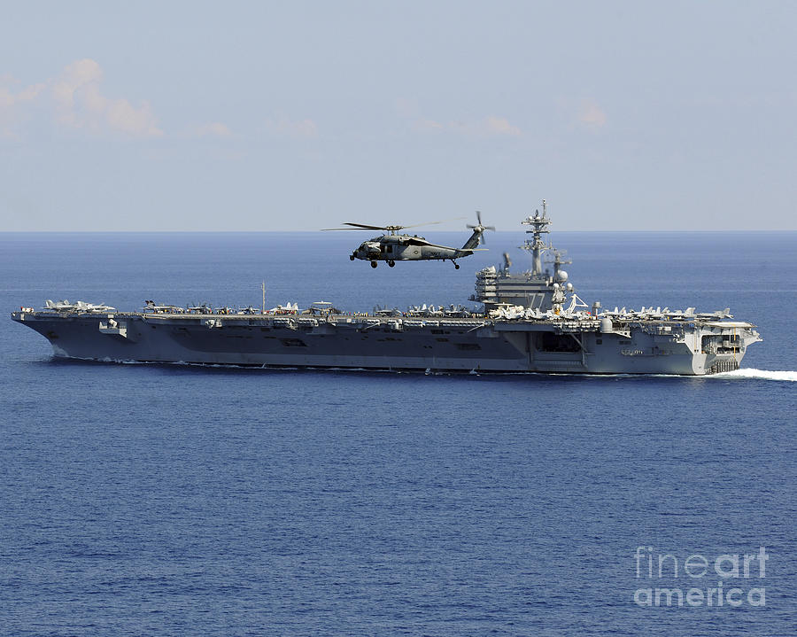 Mh-60s Photograph - An Mh-60s Seahawk Helicopter Flies by Stocktrek Images